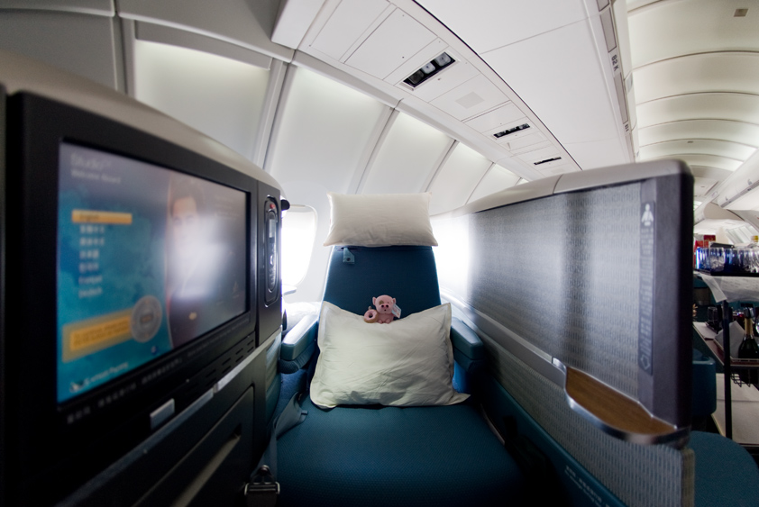 cathay pacific boeing 747-400 upper deck cabin business class first class mcdull mcmug